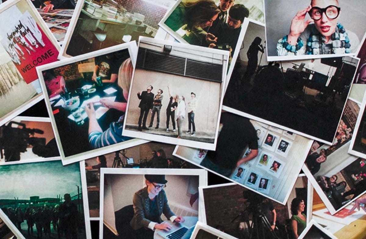 A pile of polaroid photos stacked on top of one another showing the Gershoni team in various states of work and play.