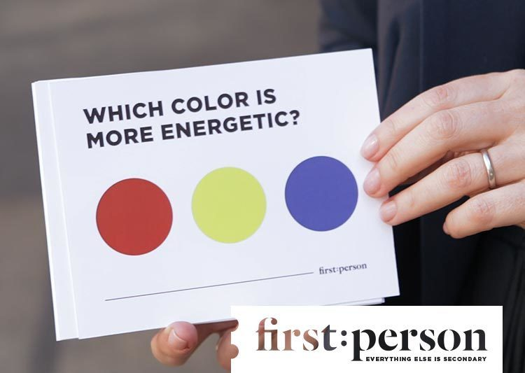 "A white card reads, ""Which color is more energetic?"" Below are 3 circles in red, yellow and blue."