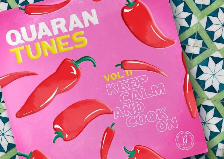 "Pink vinyl sleeve dotted with red chile peppers on a tile background. The sleeve reads, ""Keep calm and cook on."""
