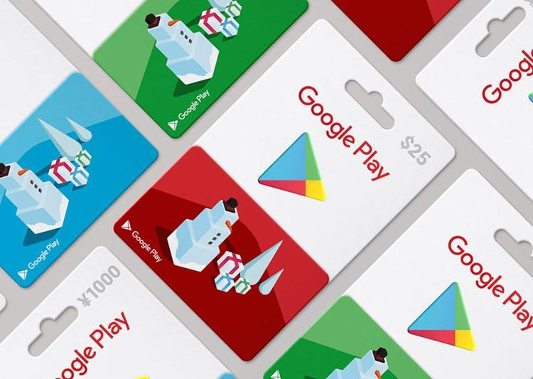 7 Google Play gift cards arranged in an overhead shot. Each gift card has a geometric snowman on the front.