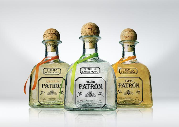 3 Patón bottles superimposed over a light grey background. The flavors are Silver, Reposado and Añejo.
