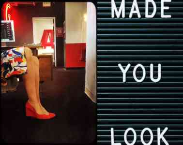 """Diptych of a pair of light-skinned legs wearing red heels, and a sign that says, """"Made you look."""""""