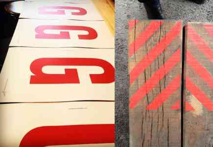 Four red screen prints of the letter G onto white paper.