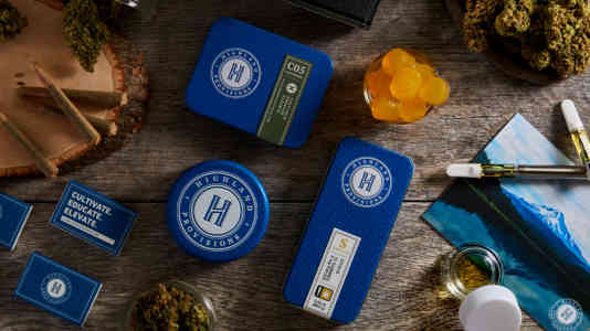 Overheat shot of Highland Provisions cannabis products, including prerolls, cartridges and gummies.