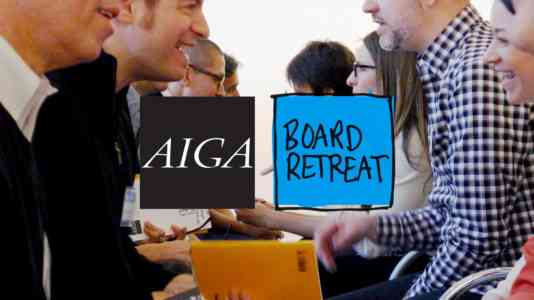 Two rows of people facing each other speak animatedly. The AIGA board retreat logo is superimposed over the photo.