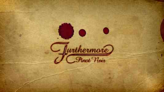 Close-up of the Furthermore label. The font is red cursive, with 3 drops of red wine above the logo.