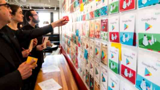 Gershoni Creative employees consider various designs for the Google Play gift card.