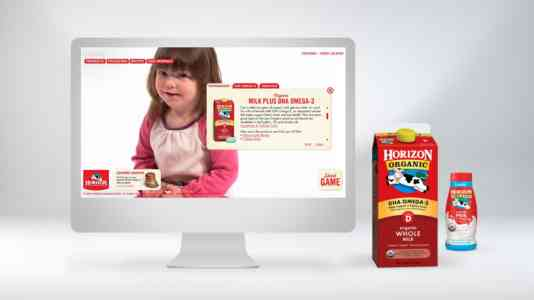 Mock-up of a computer opened to the Horizon website. To the right are a carton and a bottle of Horizon milk.