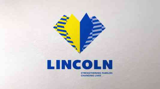Lincoln Child Center logo. It is a yellow and blue heart with blue lettering.