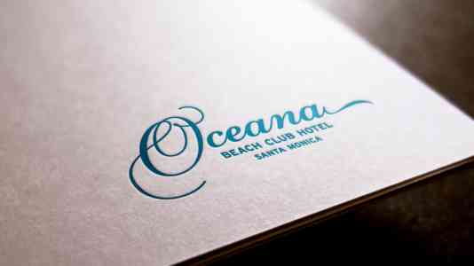 Close-up shot of the Oceana Beach Club logo embossed on a piece of paper.