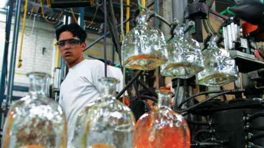 A factory worker in the Patrón bottle manufactory.