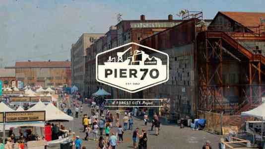 Pier 70 logo superimposed over a photo of an event at Pier 70.